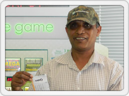 Alexandria man smiles with winning ticket